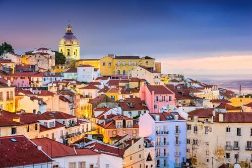 1 week in Europe in the fall | Lisbon's Alfama district at twilight