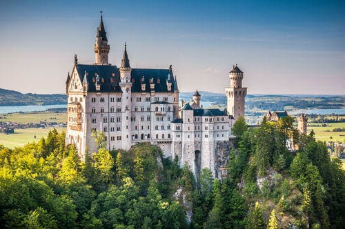 _beautiful_view_of_world-famous_neuschwanstein_castle_the_19th_century_romanesque_revival_palace_built_for_king_ludwig_ii_in_beautiful_evening_light_at_sunset_fussen_southwest_bavaria_germany