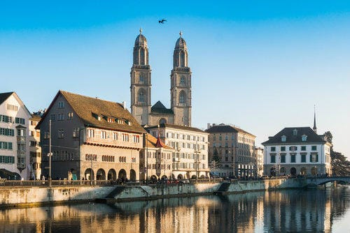 Limmat river quay and Grossmünster church