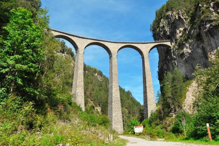 You'll pass over the 213 feet high (65m) Landwasser Viaduct, surrounded by high trees and mountains.