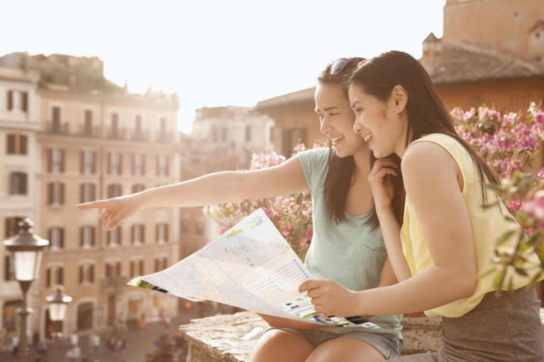 Girls looking at map in Rome