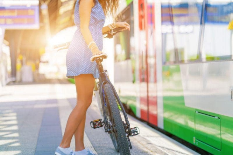 Girl with bike at station