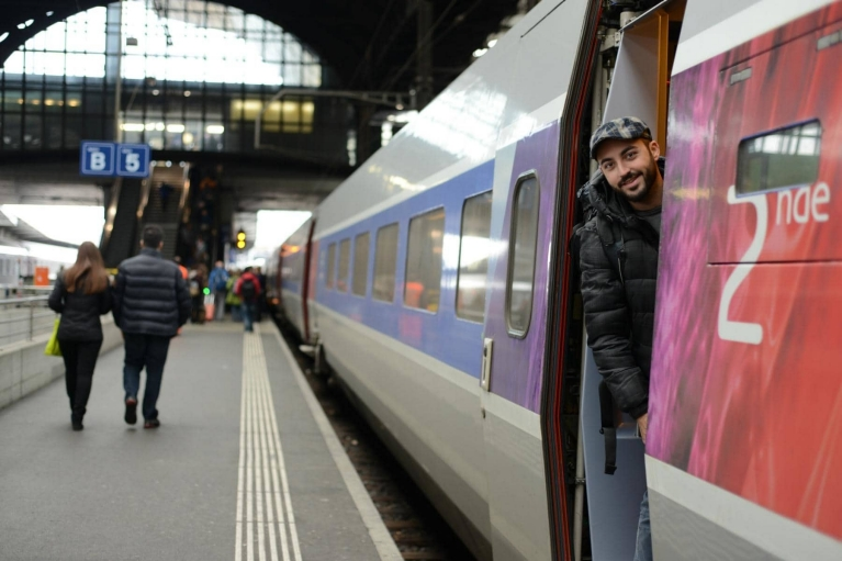 Man standing in door of TGV train, Basel, Switzerland