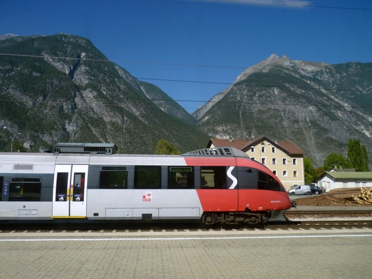A regional train arrives in an Austrian mountain village