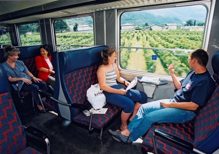 People on a regional train in Switzerland