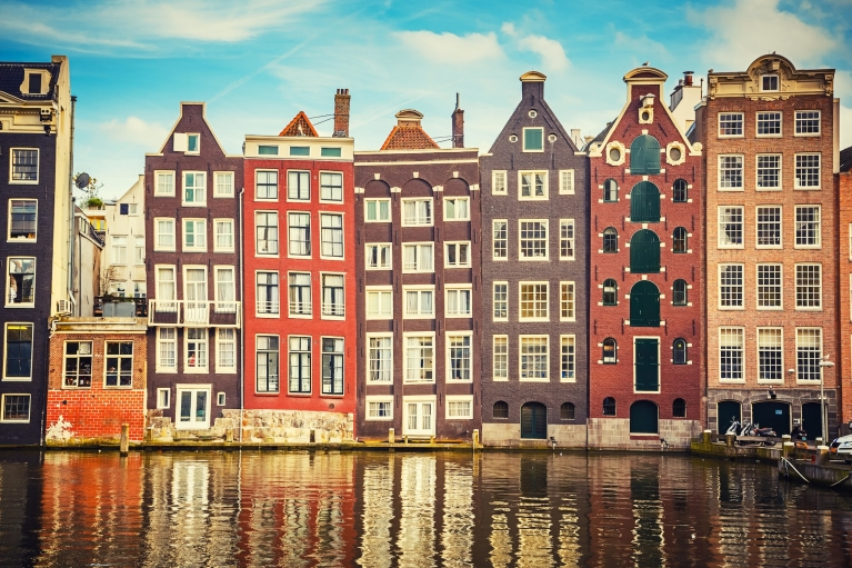 Tall, canal-side buildings in Amsterdam