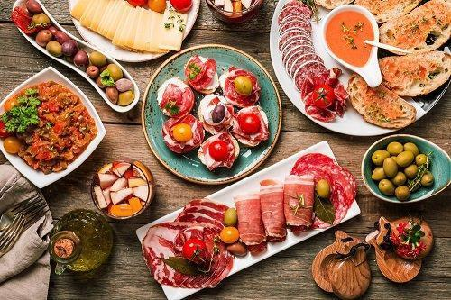 spanish_tapas_on_wooden_table_2