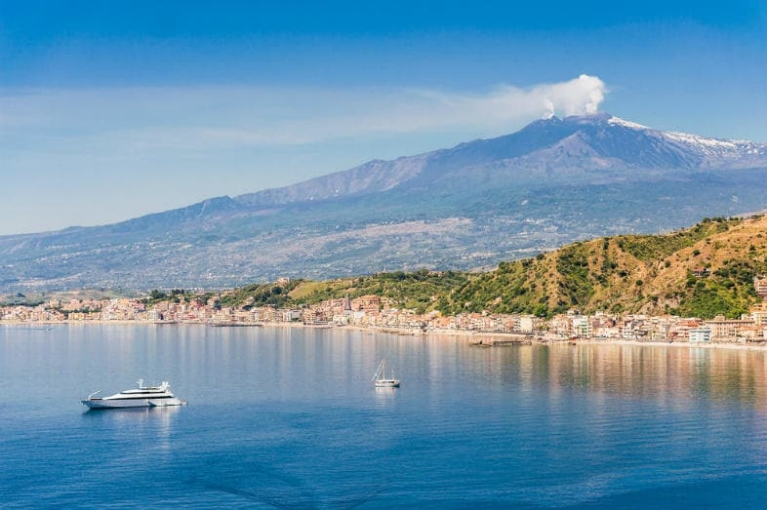 Coastal landscape of Sicily with the Etna volcano in the background