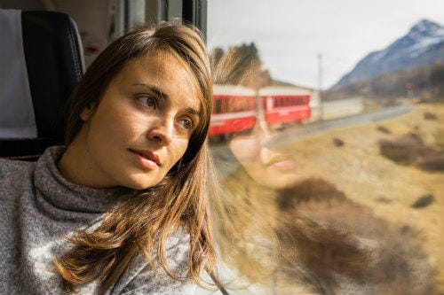 Everything about Eurail | Female leaning on the Bernina Express window
