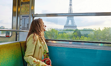 france-paris-woman-in-metro-looking-at-eiffel-tower