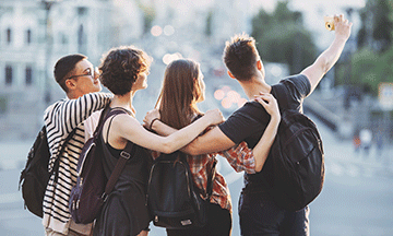 group-of-friends-travellers-taking-selfie