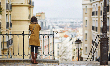 woman-enjoying-view-over-montmartre-in-paris