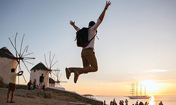 young-man-jumping-in-the-air-greece